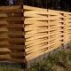 Плетёный деревянный забор на лесном участке.