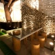 Габионы в ночном освещении. Пожалуй, сложно придумать более романтического зонирования для летнего кафе.